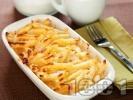 Рецепта Вкусна закуска от карамелизирани сладки макарони на фурна със сирене, яйца и масло